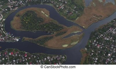 Aerial shot of a meandering river in the village