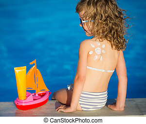 Sunscreen lotion sun drawing on childrens back. Summer...