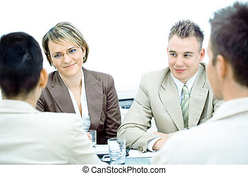 Business meeting isolated - Happy young businesspeople...