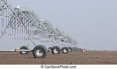 center pivot sprinkler system moving on field