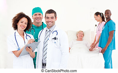 Group of Doctors with a patient - Team of Doctors with a...