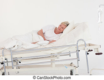 Patient Recovering in a hospital ward - Senior Patient...