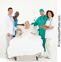 Doctors looking after a patient and bedside - Team Doctors...