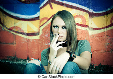 joint - portrait of young female smoking a marijuana.