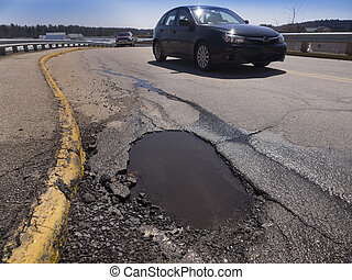 Pothole - Large deep pothole as an example of poor road...