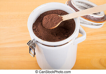 Ground Coffee in a Ceramic Canister - Fresh, ground coffee...