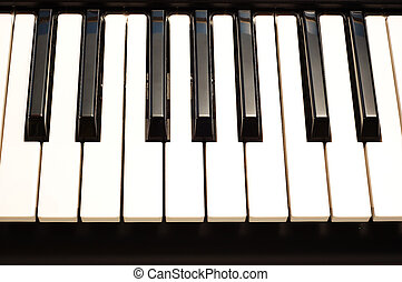 Piano keys - Close up Piano keyboard lit from above with a...