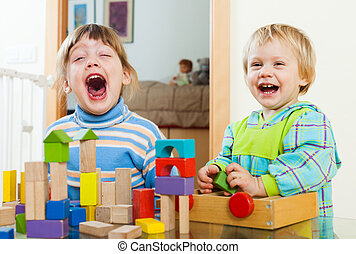 happy siblings together playing with blocks - happy siblings...