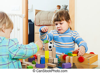 Baby  playing with toy blocks