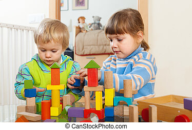 tranquil children playing with wooden toys in home interior