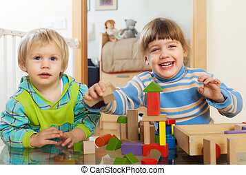 Emotional  children playing with wooden toys