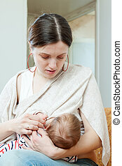 Mother breast feeding  three-month baby