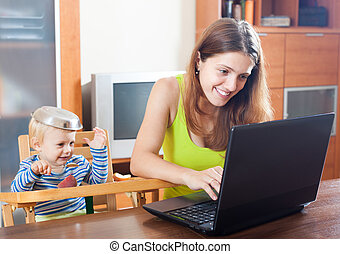 mother working at home with baby
