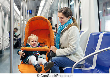 woman with crying child  at subway