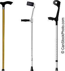 Set of orthopedic walking sticks on white background