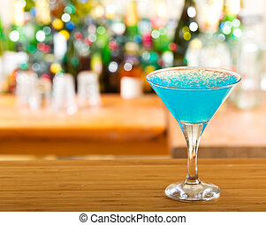 blue cocktail in a bar