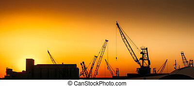 Construction cranes on industry site - Construction cranes...