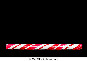 Candy Cane - Christmas candy cane on a dark surface