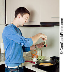 Man cooking omelet