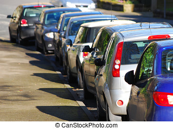 Parked cars in street - Telephoto view of cars parked in...