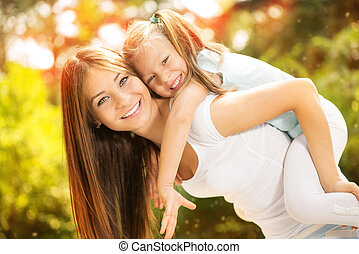 Mother and daughter in the nature - Beautiful mother and...