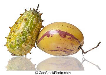 Fresh fruits - Whole Pepino and Kiwano fruits isolated on...