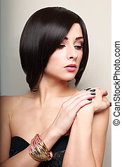 Beautiful makeup short black hair woman with bangle on the...
