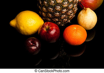 fruits - bunch of exotic fruits on black background with...