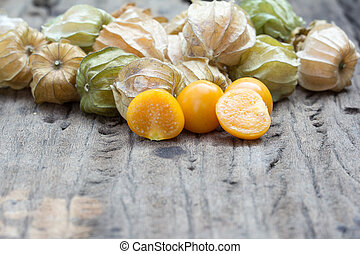 Cape gooseberry, physalis on wood background.