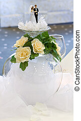 Wedding table decoration. Couple dolls. Inverted glass