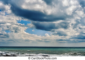 Caspian Sea - Fluffy clouds over the Caspian Sea in the...