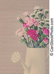 Vintage carnations in watering
