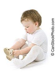 Child with shoes sitting Isolated on white