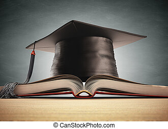 Graduation cap over the book with blackboard on background....