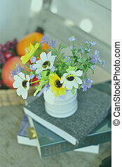 flowers on wood table in the garden