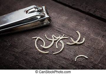 Nail clipper and nail clippings - Nail clipper and some nail...