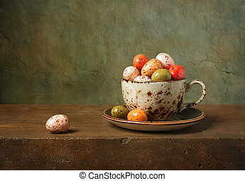 Still life with chocolate easter eggs