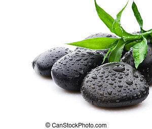 Zen black stone spa and health care concept.