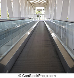 Moving Walkway - An empty, flat, exterior...