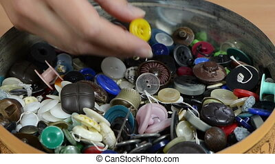 buttons finger pick - Dish full of various colorful buttons...