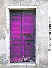 Purple door in the island of Giudecca in Venice