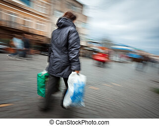 woman in a jacket with shopping plastic bags - Abstract...