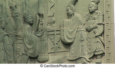 Stone Carving - Chinese stone carving on a wall, Yuyuan...
