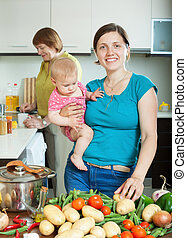 Happy women of three generations in kitchen - Happy women of...