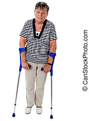 Old woman walking on crutches
