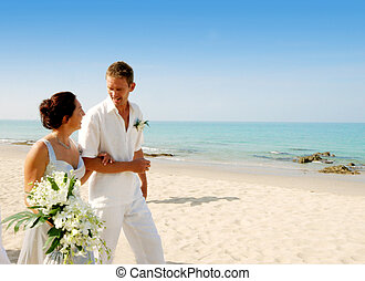 Bride and groom. - Bride and groom at the beach.