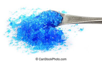 Copper sulphate with a steel spatula over white background