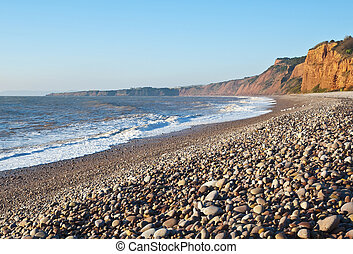 Jurassic Coast - Shingle beach and rugged red cliffs are a...
