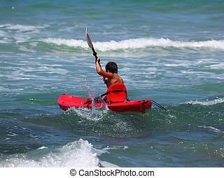 boy in boat - boy rowing in sea kayak
