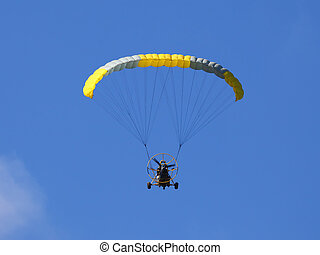 paraplane - Flying paraplane on blue sky background